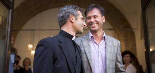 Monsignor Krzysztof Charamsa, left, and his partner Eduard, surname not given, leave a restaurant after a press conference in downtown Rome, Saturday Oct. 3, 2015. Vatican on Saturday fired a monsignor who came out as gay on the eve of a big meeting of the world's bishops to discuss church outreach to gays, divorcees and more traditional Catholic families. (AP Photo/Alessandra Tarantino)