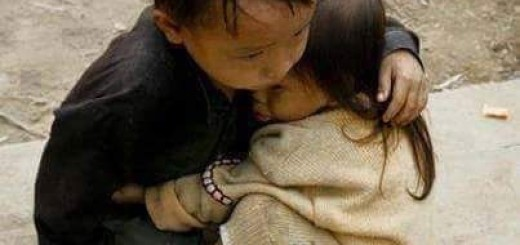 Two yr old sisters being protected by 4 yr old brother Nepal