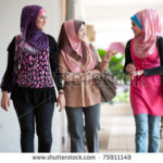 stock-photo--young-muslim-woman-in-head-scarf-walk-together-75911149