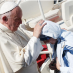 Pope Francis blesses an MC nun after Mother Teresa's canononisation