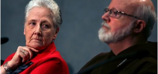 Irish abuse victim Marie Collins looks at Boston Cardinal Sean O'Malley