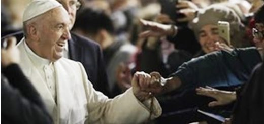 Pope holds hands with people in St Peter's Basilica
