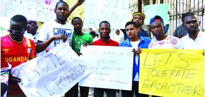 African students protest the attack against the attack on